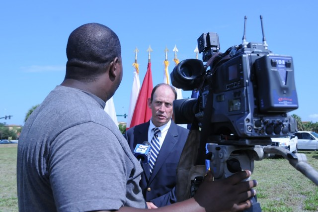 Lake Park Mayor James DuBois speaks to a reporter from WPBF channel 25 about the ground breaking for a new 64,514 sq. ft. Army Reserve Center in southern Florida on May 19. The project will cost approximeately $16 million and should be completed in the summer of 2013.
