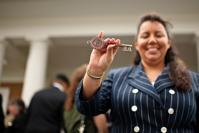 """FORT BELVOIR, Va. -- Roxannamaria Calderon, Fort Belvoir Fisher House manager, holds the ceremonial Fisher House key, which was presented during the dedication of the house which opened here May 22, 2012. The Fisher House offers service members, veterans and their families an open door while receiving care at Fort Belvoir Community Hospital. Fisher House Foundation donates and builds """"comfort homes"""" on the grounds of major military bases and VA medical centers. The homes enable family members to be near loved ones during hospitalization due to illness, or injury. The program recognizes the significant contributions and sacrifices of our men and women in uniform, and demonstrates the nation's admiration and willingness to support them and their families, particularly in their time of need. The Fisher House program was established in 1990 by Zachary and Elizabeth Fisher. (Department of Defense photo by Navy Seaman Tina Staffieri)"""