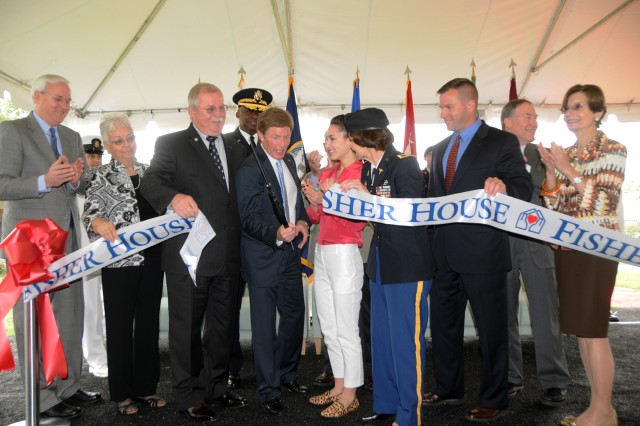Fisher House Foundation Chairman & Chief Executive Officer Ken Fisher; Col. Susan Annicelli, commander, Fort Belvoir Community Hospital and Vice Chief of Staff of the Army Gen. Lloyd J. Austin III, are among those cutting the ceremonial ribbon to open a new Fisher House at Fort Belvoir, Va., May 22, 2012.