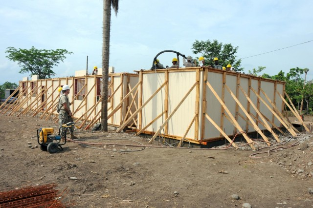 Soldiers serving on Beyond the Horizon 2012 in Honduras are building a medical clinic at the Micheletti construction site. The project is near 45 percent completion.