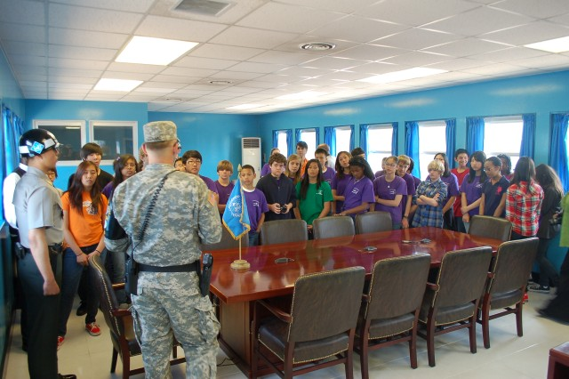 Pvt. Leonard explains to the entire group while in T-2 that all of them standing to his left are now in Communist North Korea, during the Seoul American Middle School visit to the Joint Security Area on the border of North Korea and South Korea, May 18, 2012.