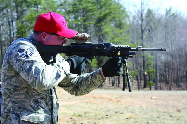 An Air Force range control officer at Marine Corps Base Quantico, Va., fires the Lightweight Small Arms Technologies light machine gun for the very first time.