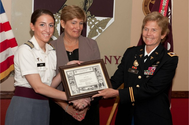 Col. Beverly Land, Keller Army Community Hospital commander, presented Firstie Anna Stein with the Richard M. Mason Memorial Award, May 22, 2012, which honors the cadet with the highest grade point average who is entering medical school. The future Medical Corps officer will be graduating West Point Saturday and continue her education at the School of Medicine at Yale University.