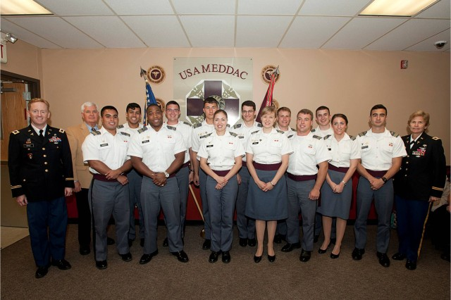 United States Military Academy Cadets pose with Col. Michael Doyle, Keller Army Community Hospital deputy commander for clinical services, Dr. Frederick Pugh, United States Military Academy associate dean and Col. Beverly Land, Keller Army Community Hospital commander, after receiving their Army Medical Regimental Crest, May 22, 2012.