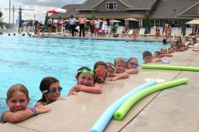 Children line up along the pool to beat the summer heat during Picerne's Pool Party last year at Bowden Terrace Neighborhood Center.