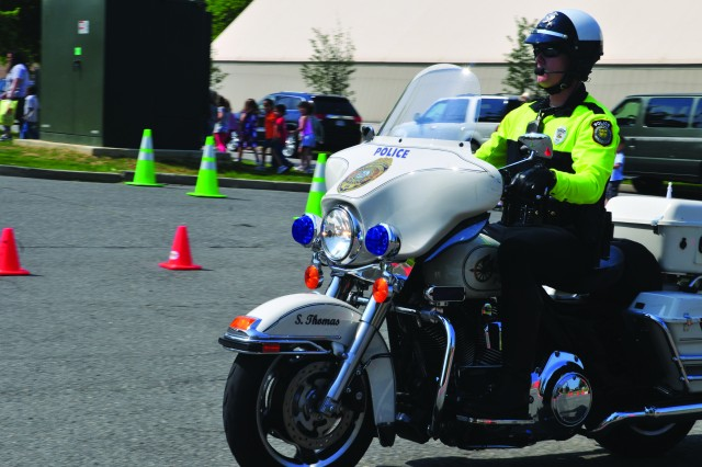 Officer Stephen Thomas, Fort Belvoir Police, demonstrates safe riding techniques.