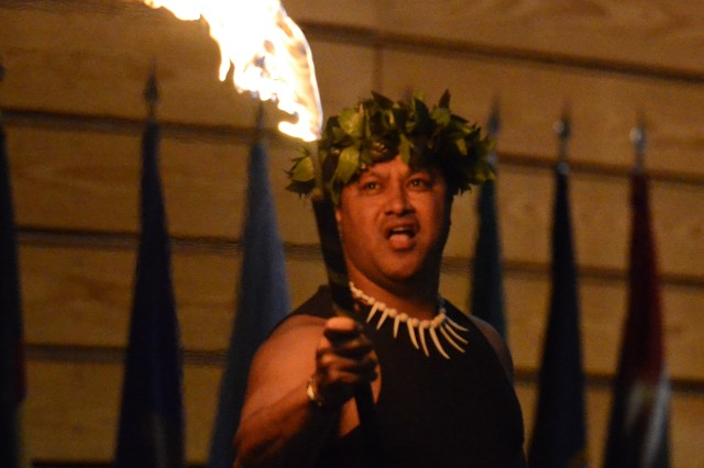 Chief Rick Olomua of the South Sea Dancers performs a Samoan fire and knife dance during Fort Jackson's Asian Pacific American Heritage Month celebration.