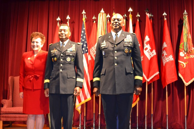 Lt. Gen. Thomas P. Bostick, U.S. Army Corps of Engineers commanding general (center), stands with his wife, Renee (left), and Gen. Lloyd J. Austin III, U.S. Army vice chief of staff (right), after officially assuming duties as the U.S. Army Corps of Engineers commanding general and chief of engineers during a ceremony at Fort Lesley J. McNair in Washington, D.C., May 22, 2012.