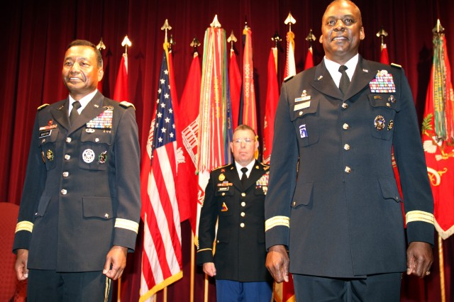 U.S. Army Corps of Engineers Commanding General Lt. Gen. Thomas P. Bostick (left), with Command Sgt. Maj. Micheal Buxbaum (center), USACE command sergeant major, and Army Vice Chief of Staff Gen. Lloyd J. Austin III (right), following the pinning of the MacArthur Castles on Bostick.