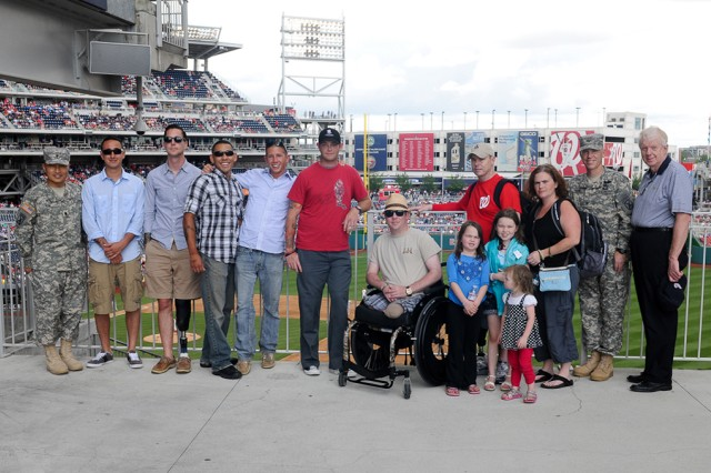 Wounded Soldiers from 3rd Brigade Combat Team pose with Col. Patrick D. Frank, second from right, 3rd BCT commander, and Chaplain (Lt. Col.) Chul Kim during a visit May 15 to the Washington Nationals game in D.C.