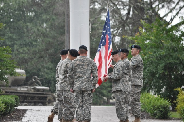 Soldiers with the Soldier Support Institute prepare to fold the American flag at the end of the retreat and salute to retirees ceremony May 17 at Post Headquarters.