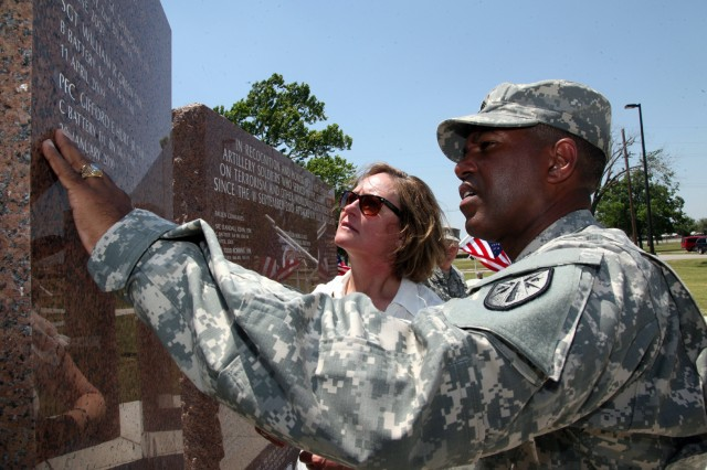 Command Sgt. Maj. Dwight Morrisey, Fires Center of Excellence and Fort Sill CSM, and Connie McDonald, First Lady of Fort Sill, admire the III Corps artillery Soldiers memorial at the rededication of Constitution Park May 18 at Fort Sill. The park, originally dedicated Sept. 17, 1987, was moved from Sheridan Road and placed next to the Field Artillery Museum.