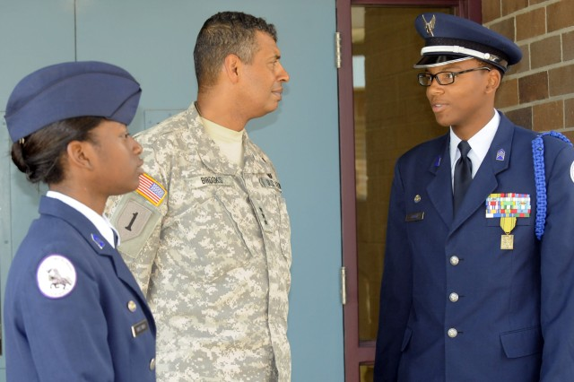 Lt. Gen. Vincent K. Brooks, Third Army/ARCENT commanding general speaks to Shaquanda Sweetnam, left, and Deshawn Abbott, right, 11th-grade cadets in the Crestwood High School JROTC during a tour of schools in the Sumter School District in Sumter, S.C. Thursday, May 24.