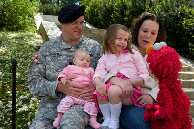 Elmo visits a military family, bringing love and understanding and joy to their daughter.