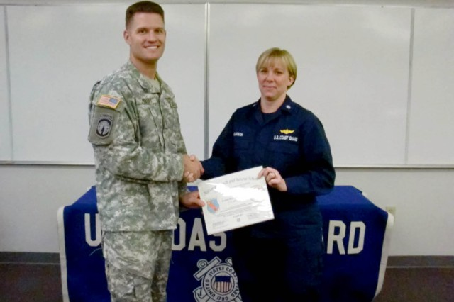 Maj. Shawn Hebert, U.S. Army Kwajalein Atoll provost marshal, is the first U.S. Soldier to complete the U.S. Coast Guard Maritime Search Planning course. Right, U.S. Coast Guard Commander K.L. Garran, chief of National Search and Rescue School, congratulates Hebert on completing the course.