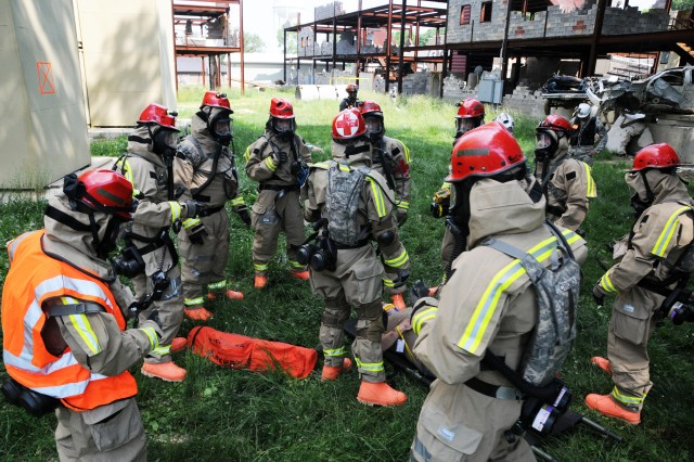 Members of the Kentucky National Guard receive a brief on extracting the injured and wounded during the early stages of their external evaluation at Muscatatuck Urban Training Center in Butlerville, Ind. May 23, 2012. The purpose of the exercises and evaluation is to prepare the Kentucky Guard's chemical, biological, radiological, and nuclear (CBRN) teams to respond to such attacks and disasters. (Photo by: Spc. David Bolton, Public Affairs Specialist, 133rd Mobile Public Affairs Detachment, Kentucky Army National Guard).