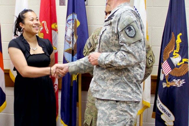 USAKA/RTS Commander Col. Joseph Gaines thanks Pfc. Gracelynn Livai for her service in the U.S. Army and gives her a USAKA Commander's Coin.