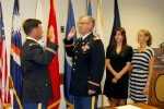 Travis Cornett takes oath during promotion