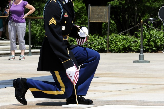 "Sgt. Christopher Anthony, Sentinel, Tomb of the Unknown Soldier, 3d U.S. Infantry Regiment (The Old Guard), places a flag at the Tomb of the Unknown Soldier, Arlington National Cemetery, Va., May 24, 2012. The ceremony known as ""Flags In"" is performed to commemorate and honor U.S. military personnel ahead of the upcoming Memorial Day weekend and has been conducted annually since 1948"