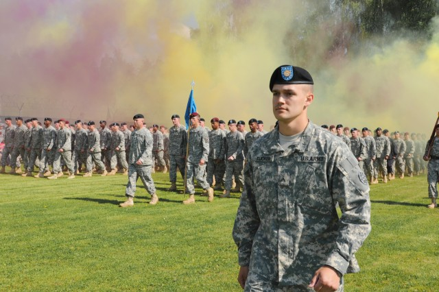 Cpl. Lane B. Tucker leads over 250 graduates of the Warrior Leaders Course, Class 08-12, at the 7th Army Non-Commissioned Officer Academy in Grafenwoehr, Germany, May 24, as part of the graduation ceremony. Class 08-12 conducted an 18-day course consisting of physical readiness training, drill and ceremony training, oral presentations, and more while learning what it takes to be a non-commissioned officer.  (U.S. Army photo by Pfc. Chalon Hutson, 301st Public Affairs Detachment.)