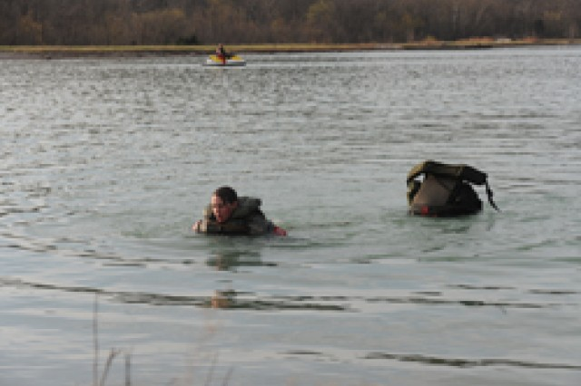 Capt. Christine Murray climbing out of the frigid water after the helocast and swim event of the 2011 Best Sapper competition.