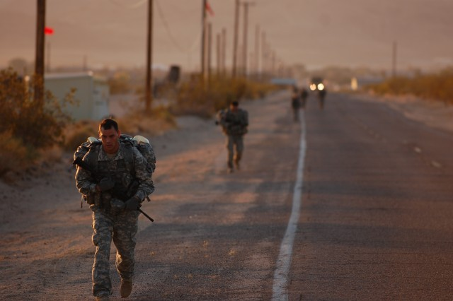 Troopers from the 11th Armored Cavalry Regiment conduct a 12-mile ruck march as part of the 11th ACR's Pre-Ranger Course at Fort Irwin May 9. The course is designed to test and train Troopers for the initial phase of the Army Ranger School.