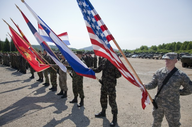 Sgt. Eric Sullins, with U.S. Army Europe's 2nd Calvary Regiment, holds the U.S. flag before the opening ceremonies of the Immediate Response 2012 training event held in Slunj, Croatia, May 26, 2012.