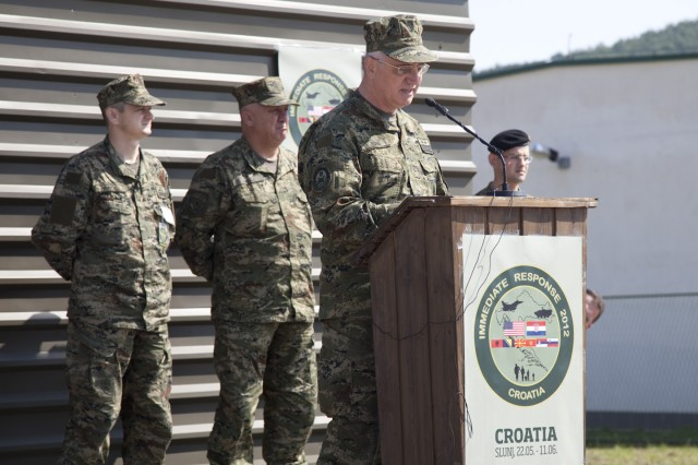 Maj. Gen. Dragutin Repinc, commander of the Croatian Land Forces, speaks to a multinational armed forces formation, which begins day one of the Immediate Response 2012 training event held in Slunj, Croatia, May 26, 2012.