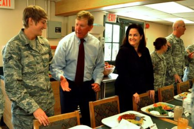 Terry Yonkers (center), assistant secretary of the Air Force for installations, environment and logistics, jokes with Air Force Airman 1st Class April Hill (left), from Tuscaloosa, Ala., and Katherine Hammack, assistant secretary of the Army for installations, energy and environment. Yonkers and Hammack shared lunch with representatives of the Army and Air Force at the Camp Bullis dining facility during a visit and tour of Joint Base San Antonio, May 21-22, to discuss world-wide and future energy and environmental initiatives for their respective services.
