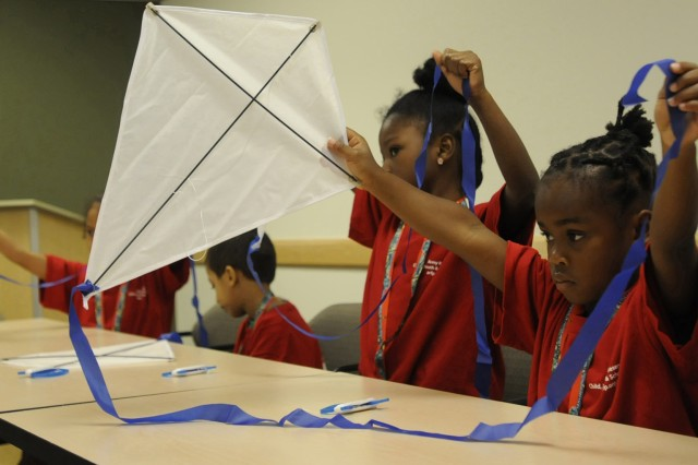 "Young scientists build and design their own kites during the  ""Up, Up, and Away"" day camp hosted by the 81st Regional Support Command's Child Youth & School Services and the Mad Science organization on May 19."