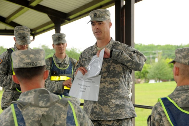 Master Sgt. Micah Huling, a 20th Support Command (CBRNE) Operations NCO and NCOIC of the 2012 20th Spt. Cmd. (CBRNE) Best Warrior Competition, briefs participants in the competition on urban orienteering at APG's Edgewood Area May 21
