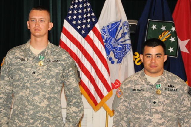 "(From left) Sgt. Michael Turner and Spc. David Nakasone stand before members of the 20th Support Command (CBRNE) after being selected as the 2012 NCO and Soldier ""Best Warriors"" May 24."