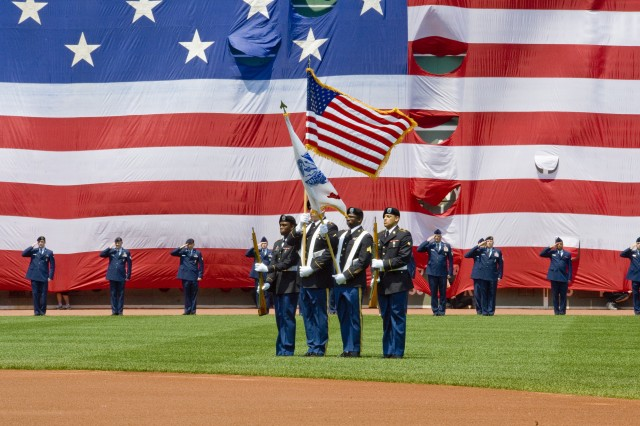 The U.S. Army Research Institute of Environmental Medicine Color Guard presents the Colors during the pregame ceremonies at Fenway Park in Boston, on Memorial Day 2012.