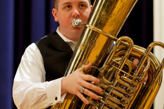 Eric William Black, the 2012 Young Artist Competition winner, performs on his tuba April 27.  Black was amongst three finalists selected to perform in front of The United States Army Field Band panel.
