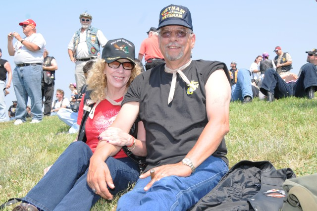 """Ron Lambert and wife, Eileen, were among thousands of motorcyclists to gather at the Pentagon in Arlington, Va., to participate in the 25th """"Rolling Thunder"""" motorcycle rally, May 27, 2012. The event is in its 25th year now. Participants from around the United States gathered at the Pentagon before embarking on a ride around the National Mall in Washington, D.C. This year's Rolling Thunder coincides with the 50th anniversary of the start of the Vietnam War. Many of the participants in the rally are veterans of that war. The rally brings attention to prisoners of war and those missing in action."""