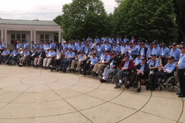 Oklahoma veterans pose for a photo at the World War II Memorial in Washington, D.C., during a May 4 Honor Flight. A Soldier with 3rd Battalion, 290th Regiment, 479th Field Artillery Brigade, Division West, based out of Mustang, Okla., acted as a guardian for the veterans during the one-day trip. (Courtesy photo)