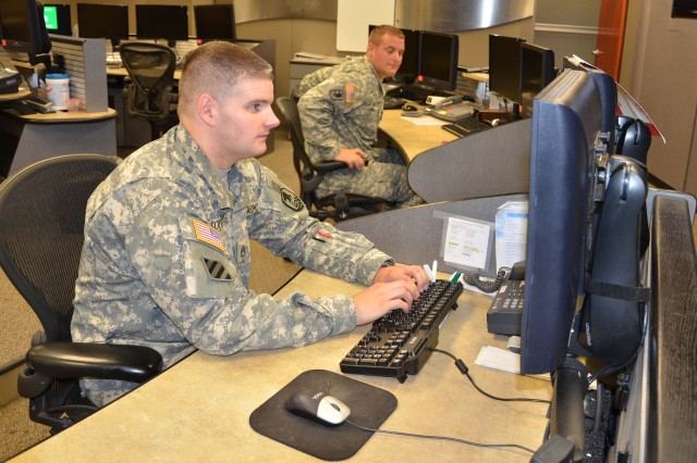 Staff Sgt. Alan Soderberg works at his console in the U.S. Army Space and Missile Defense Command/Army Forces Strategic Command Operations Center on Peterson Air Force Base, Colo. Soderberg joined the Army in October 2003.