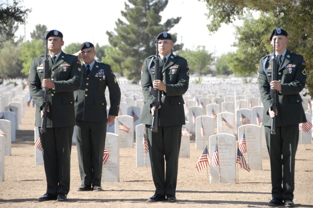 Soldiers present arms after firing a 21-gun salute during the May 28 Fort Bliss National Cemetery Memorial Day Ceremony.