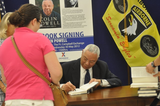 "Jennifer Krog watches as Colin Powell signs a copy of his new book, ""It Worked for Me: In Life and Leadership,"" at Fort Campbell's Post Exchange Wednesday afternoon. Powell, who once served as 2nd Brigade commander for the 101st Airborne Division in 1976, revisited the installation on the Kentucky-Tennessee state line as a part of his book tour. He also met with 101st Airborne Division Commanding General Maj. Gen. James McConville during his visit."