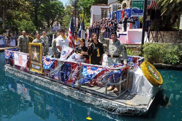"SAN ANTONIO, Texas - Lt. Gen. William Caldwell IV, commanding general, U.S. Army North, and senior commander, Fort Sam Houston and Camp Bullis, waves to spectators May 19 as Grand Marshal of the ""Here's to our Heroes"" Military River Parade. The inaugural parade opened at the Arneson River Theater and featured 25 river floats, representing all branches of the military, veterans, military support groups and more, in honor of Armed Forces Day. (U.S. Army photo by Staff Sgt. Keith Anderson, Army North PAO)"