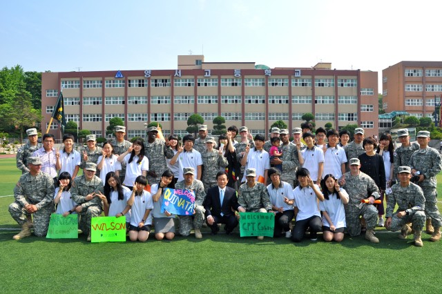 Soldiers take a group photo with Yangseo High School students who worked as their guides, teachers and friends during the event, May 25.-U.S. Army photo by Cpl. Choi Sung-il