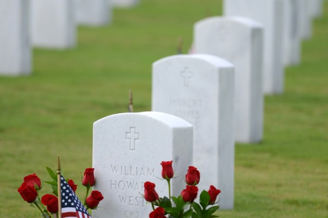 graves at Fort Jackson National Cemetery are adorned with flags for Memorial Day.