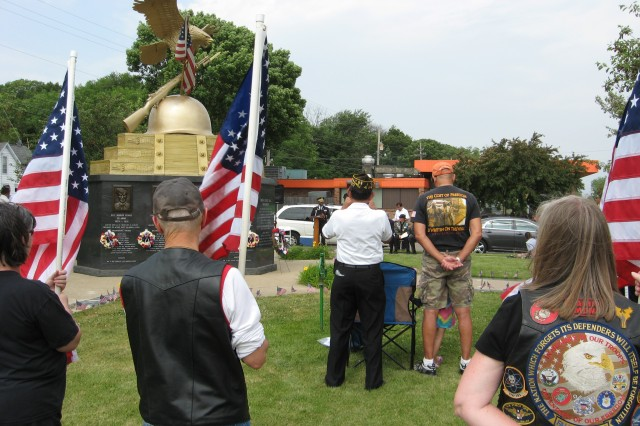 More than 100 people gathered at the Hero Street Monument in Silvis, Ill. May 26 to hear Col. Richard Dix, U.S. Army Sustainment Command chief of staff, speak about the importance of remembering those who gave their lives in defense of our nation.
