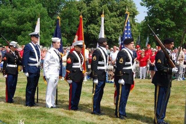 A multi-service color guard including Soldiers from the U.S. Army Sustainment Command prepares to post the colors at the annual Memorial Day observance held May 28 at Rock Island National Cemetery on Rock Island Arsenal, Ill.  Maj. Gen. Patricia E. McQuistion was among the guests of honor at the observance.