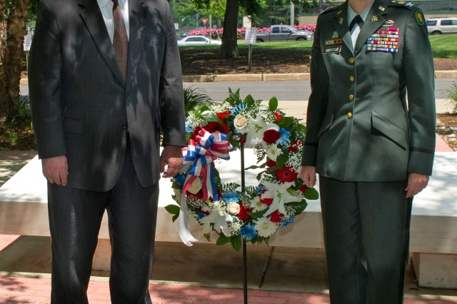 Col. (P) Jody J. Daniels, deputy commanding general of First Army Division East, and Michael J. Astrue, commissioner of Social Security, lay a wreath during the Social Security Administration's Memorial Day Observance.
