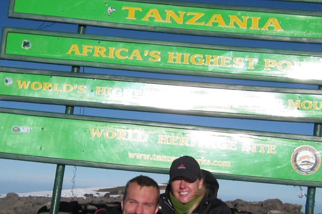 FORT CARSON, Colo. -- Staff Sgt. Sandra Ambotaite, Warrior Transition Battalion, poses for a photo with Kyle Maynard, a quadruple amputee, after reaching the summit of Mount Kilimanjaro. Maynard led a team of eight climbers with the goal of inspiring people to understand any obstacle can be overcome.