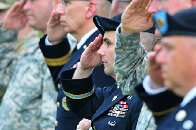 Col. John Strycula, Fort Belvoir garrison commander, salutes while the national anthem is played during Fort Belvoir's Memorial Day service.