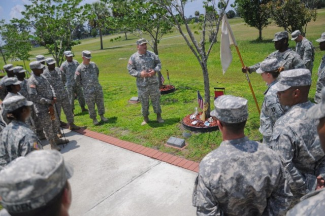 "Soldiers from 26th BSB, 2HBCT, 3rd ID, honor fellow ""Challenger"" Soldiers by telling their personal stories of each of the unit's fallen Soldiers, during a tree re-dedication ceremony held at Fort Stewart's Warriors Walk, May 24."