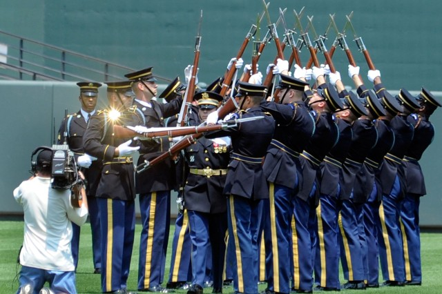Members of the U.S. Army Drill team performs one of its signature maneuvers during the pregame festivities at Camden Yards.