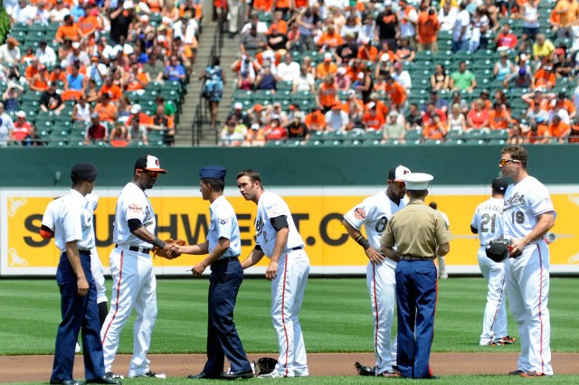 Fort Meade service members meet with members of the Baltimore Orioles before Sunday's game against the Kansas City Royals. Service members stood with the starting lineup during the National Anthem at Oriole Park at Camden Yards.